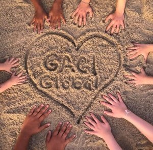 Hands around GACI Global drawn in the sand